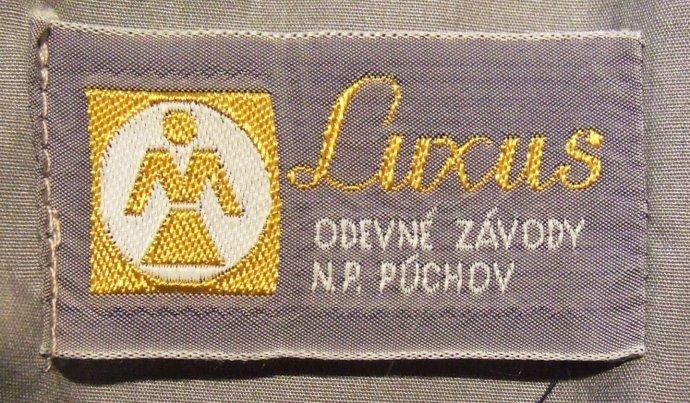 Etiketa scharakteristickým logom ženskej figúrky (spísmenom M), luxusná línia značky Makyta.
