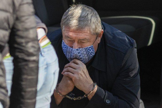 Dušan Kováčik v momente, keď ho v októbri zadržali. Foto - TASR